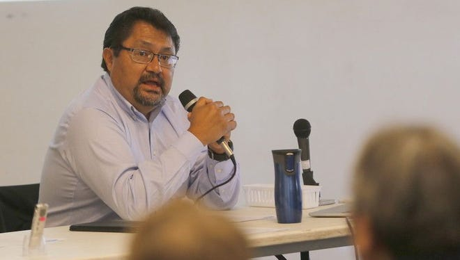 Leonard Gorman, executive director for the Office of Navajo Nation Human Rights Commission, explains the purpose of a seminar that focused on funeral home practices and consumer rights in May at Navajo Technical University in Crownpoint.