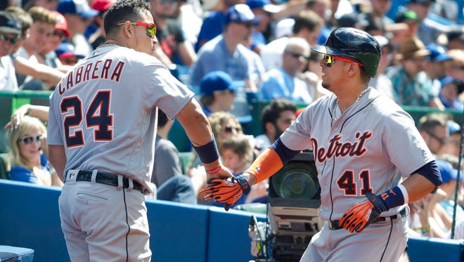 Tigers DH Victor Martinez, right, celebrates his home run with first baseman Miguel Cabrera during the eighth inning in Toronto on July 9.