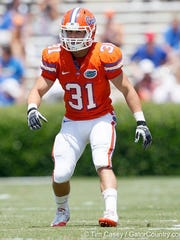 Gulf Coast graduate Brian Biada plays in the University of Florida's Orange and Blue preseason scrimmage. Biada was a walk-on with the Gators from 2009-11.