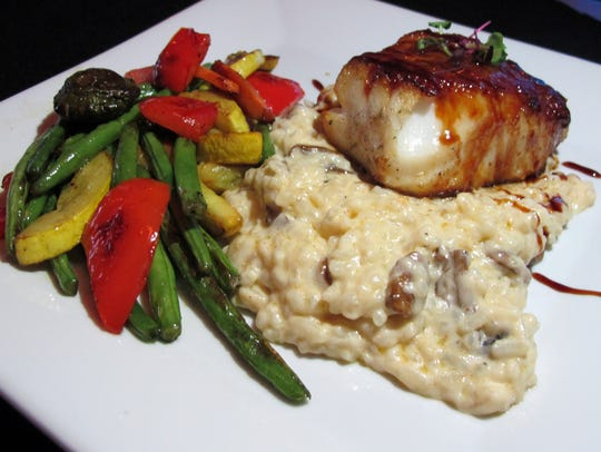 Sea bass miso with mushroom risotto and a vegetable