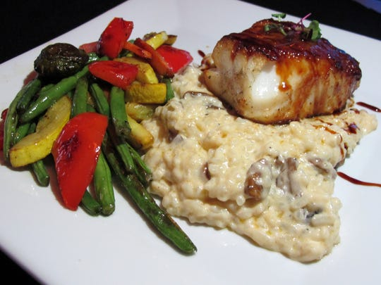 Sea bass miso with mushroom risotto and a vegetable medley at Naples Coastal Kitchen in North Naples.