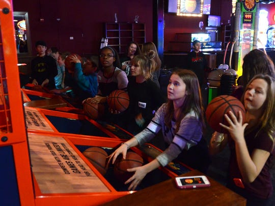 A group of kids plays a basketball game during their Dec. 29 visit to Novi's Lucky Strike.