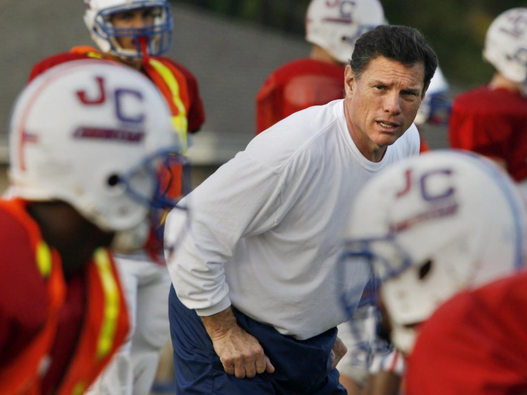 John Curtis football coach J.T. Curtis runs his players through practice in a previous season.