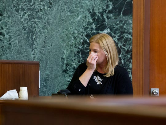 Nicole Beverly takes a moment to wipe tears away during her testimony against her ex-husband on Monday, April 2, 2018, at Washtenaw Country Trial Court in Ann Arbor.