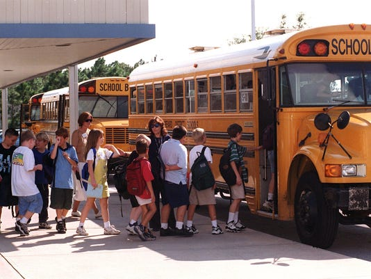 Students board school buses at Discovery