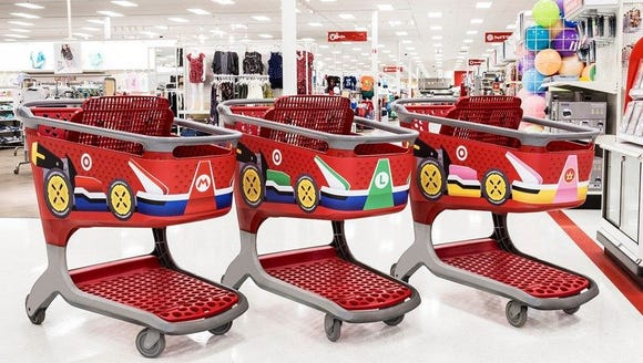 Target shopping carts decorated to look like vehicles