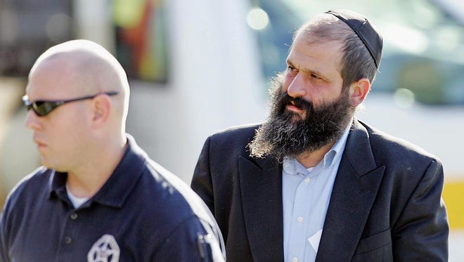 Sholom Rubashkin, right, heads to a court appearance in Cear Rapids on Oct. 30, 2008.
