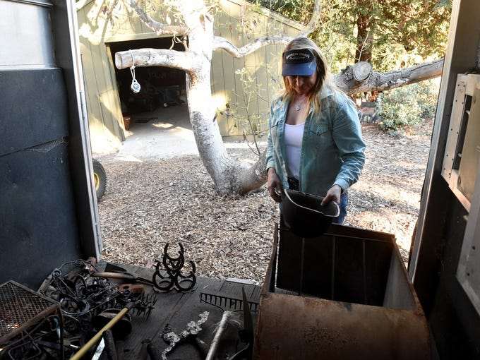 Stacy Hyatt sorts through the few tools items recovered