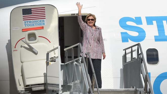 Hillary Clinton waves to the crowd as she boards her airplane at the Vero Beach Regional Airport after speaking at a rally at the  Sunrise Theater in Fort Pierce.