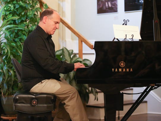 Composer Neil Berg plays a selection during the Bridging