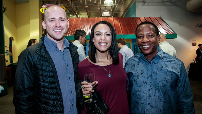 Tyler Fuller, Kelsey Webster and Michael Webster at the Wine and Whiskey at the Wetlands event at Discovery Center at Murphee Springs.