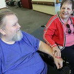 """Davy Jones and his wife of one week Penny Jones still display their """"Just Married"""" signs on the back of their wheelchairs at the Marion Manor Nursing Home on Friday, Aug. 15, 2014. James Miller/The Marion Star"""