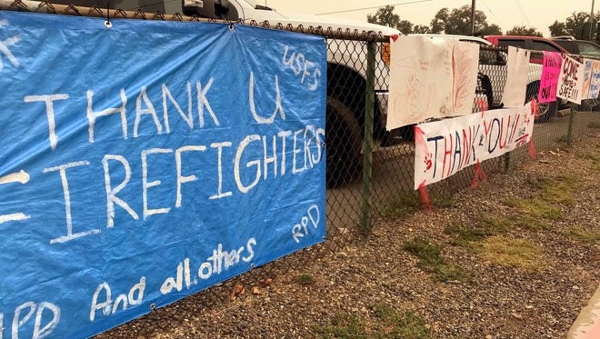 These signs were hung along the fence outside the Shasta District Fair grounds Monday morning.