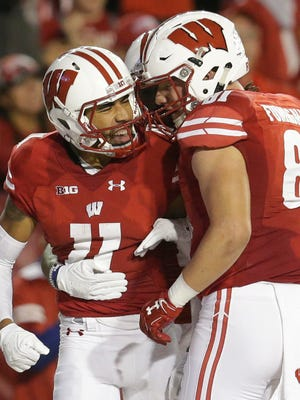 Wisconsin wide receiver Jazz Peavy (11) celebrates his TD catch.