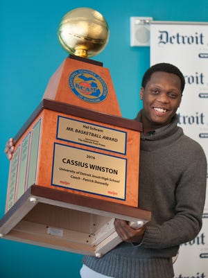 Cassius Winston holds the Mr. Basketball trophy Monday in Detroit.