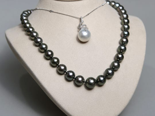 A Tahitian pearl necklace with white gold clasp $2,500 (bottom) and a white Southseas pearl on white gold and diamond necklace $2,650.