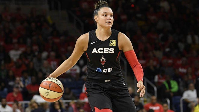 Las Vegas Aces guard Kayla McBride dribbles the ball during Game 2 of a WNBA playoff series against the Washington Mystics on Sept. 19, 2019, in Washington.