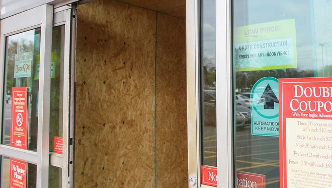 A wood tunnel is for customers to enter Ingles on North Main Street in Anderson as a Starbucks is added to store.