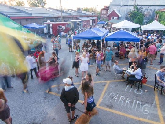 The Pine Street corridor makes up the economic and cultural hub of the South End. One of the area's big summer events is the Truck Stop gathering behind Arts Riot.