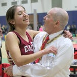 Elmira's Abbey Wheeler in the embrace of team coach Ben Cardamone after finishing second in the state Indoor Track & Field championships at Barton Hall.