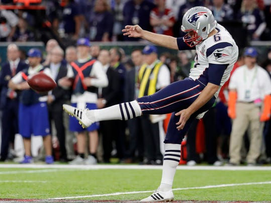 FILE - In this Feb. 5, 2017, file photo, New England Patriots' Ryan Allen punts against the Atlanta Falcons during the first half of Super Bowl 51 NFL football game in Houston. The Patriots and the Philadelphia Eagles are set to meet in Super Bowl 52 on Sunday, Feb. 4, 2018, in Minneapolis. (AP Photo/Eric Gay, File)