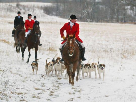 Lucius O. Hamilton III leads a fox hunt in 2003.