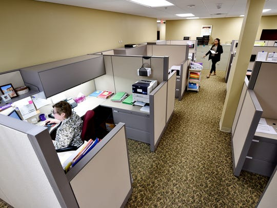 Lois Pendergrass, a mortgage and consumer loan analyst, works at her desk at York Traditions Bank's administrative headquarters in York Township. Office and administrative support jobs are the most common in York County, with more than 30,000 people occupying such positions.