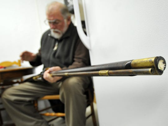 Gary Clark, 64, of Wittenberg, demonstrates how a muzzleloader works in 2011 at Central Wisconsin Firearms in Wausau.
