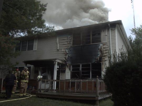 Chillicothe firefighters work to extinguish the fire at Rhonda Sommers' apartment on Sept. 5, 2008. Investigators later discovered Casey Pigge had killed Sommers and then set the apartment on fire.