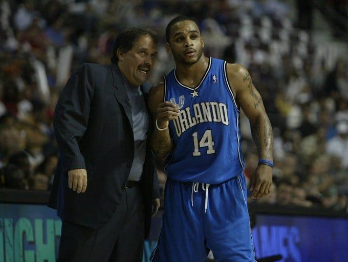 Orlando Magic coach Stan Van Gundy talks with point
