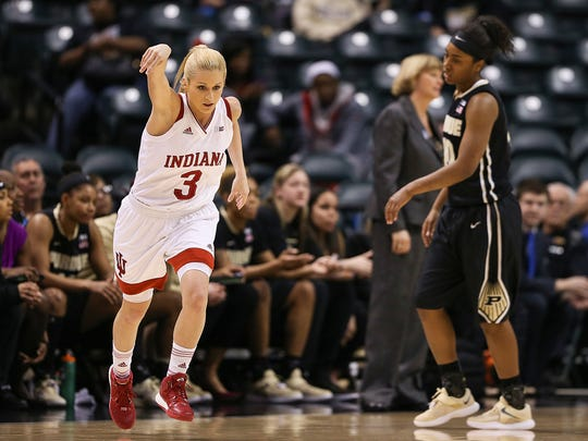 Indiana guard Tyra Buss (3) holds her shooting arm up after sinking a 3-pointer in the Big Ten women's basketball tournament at Bankers Life Fieldhouse, March 3, 2017.