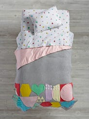 In this photo provided by The Land of Nod, design motifs