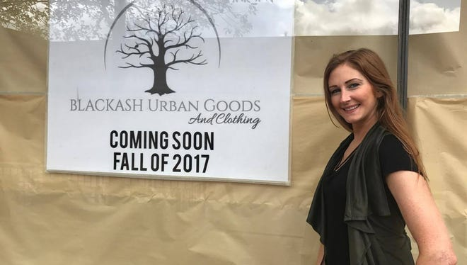 Ashley Mantor stands in front of her new store, Blackash Urban Goods, which will open this fall in downtown Wausau.