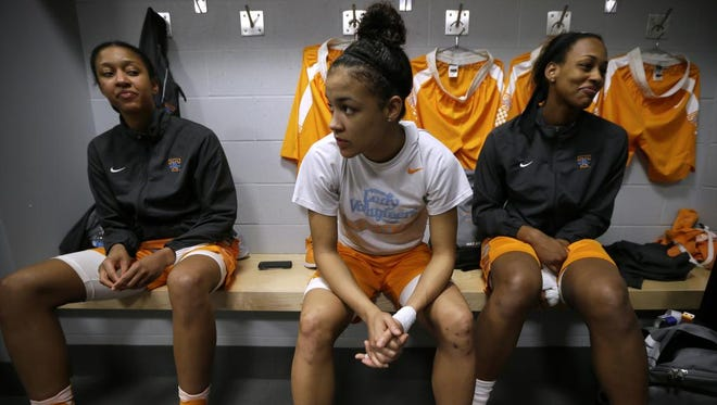 Tennessee players Jaime Nared, left, Andraya Carter, center, and Bashaara Graves, right, wait in the locker room before practice Saturday in Sioux Falls, S.D., site of Sunday's NCAA Tournament regional final against Syracuse.