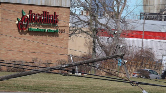 Downed power lines in front of FoodLink on Mt. Read Boulevard access road.