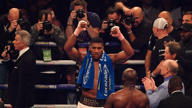 Anthony Joshua celebrates victory after a 10th round stoppage during his Saturday fight.