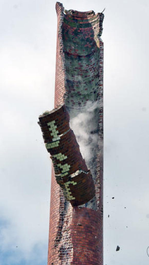 "Billy Foust's smokestack is brought most of the way down after Mother Nature damaged its top with a 2012 lightning strike. Actually, this smokestack went up long after distiller William Foust's heyday as chief of whiskey making in the company town of Foustown, near Glen Rock. Foustown was a bustling hamlet in its day. Today, it's a ghost town and only a stub of the stack stands. Those are the bricks that spelled out ""Foust"" coming down in this photo.  - Jim McClure"