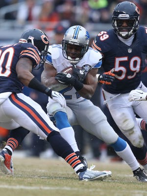 Lions running back Joique Bell runs against the Chicago Bears during first half action on Sunday.