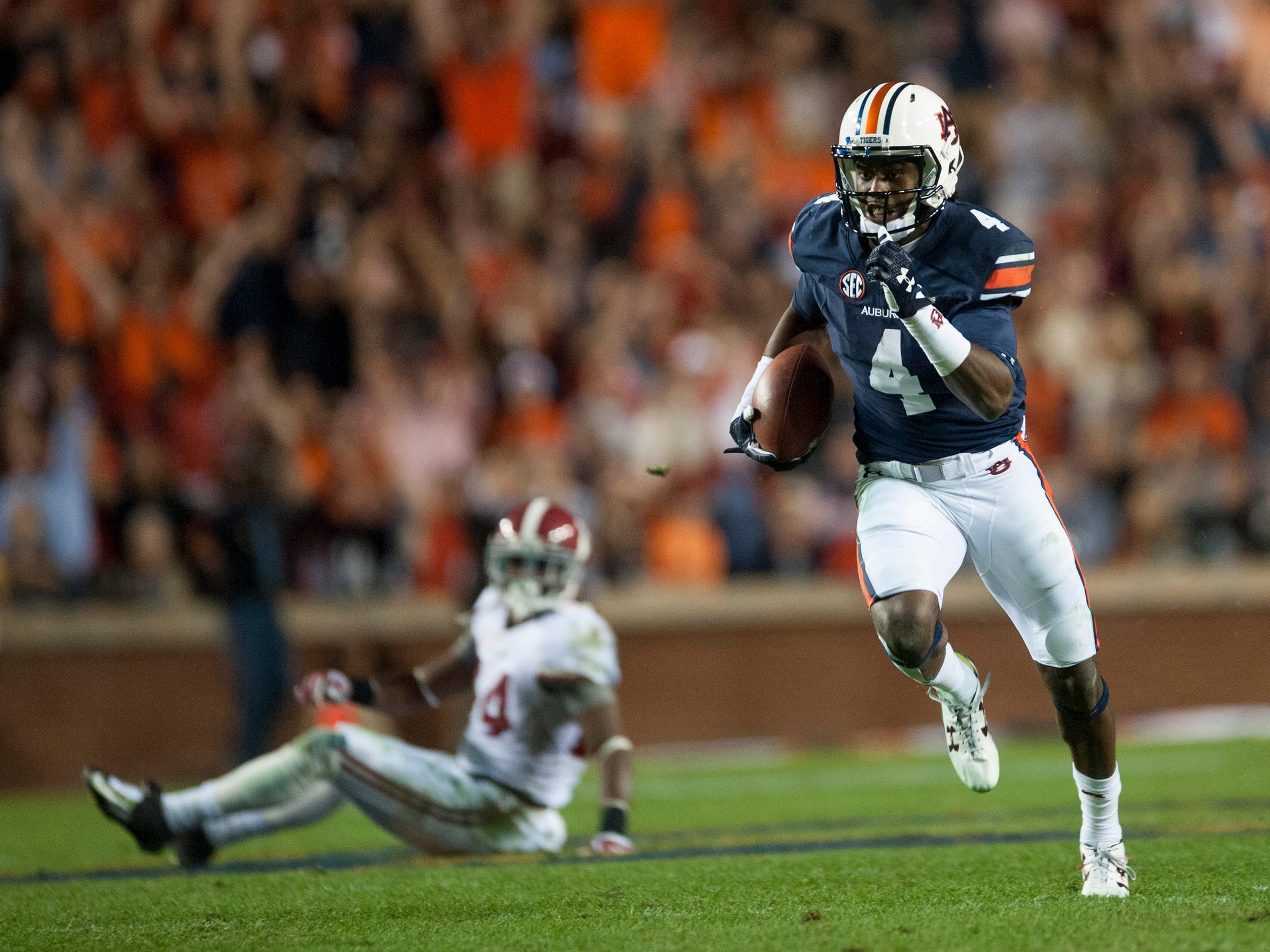 Auburn wide receiver Jason Smith (4) carries in a reception for a touchdown against Alabama during the Iron Bowl at Jordan-Hare Stadium in Auburn, Ala. on Saturday November 28, 2015. (Mickey Welsh / Montgomery Advertiser)