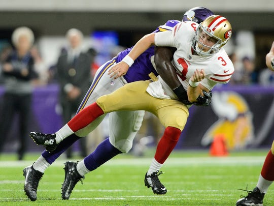 MINNEAPOLIS, MN - AUGUST 27: Jaleel Johnson #94 of the Minnesota Vikings hits C.J. Beathard #3 of the San Francisco 49ers after a pass in the preseason game on August 27, 2017 at U.S. Bank Stadium in Minneapolis, Minnesota. The Vikings defeated the 49ers 32-31. (Photo by Hannah Foslien/Getty Images)