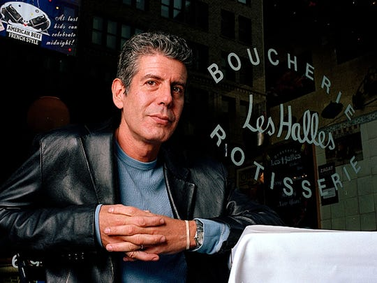 Anthony Bourdain, seen here sitting outside his restaurants,
