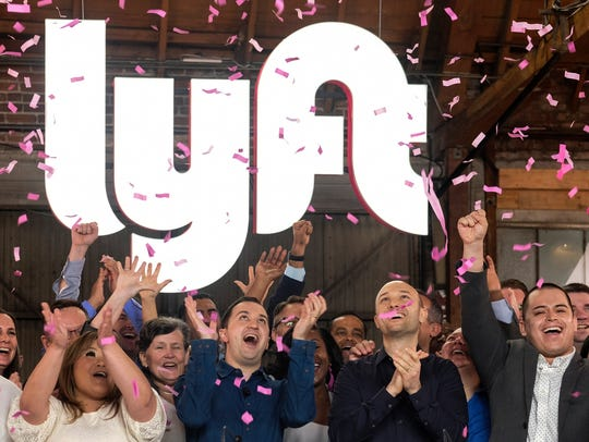 Lyft co-founders John Zimmer and Logan Green cheer