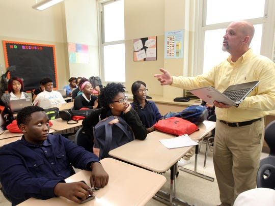 AP DISPARITY AUGUST 26 2015 Kraig (cq) Hoover, talks with students in his blended-Advanced Placement, a new blended learning programs that offers courses to students who otherwise wouldn't qualify for them. The Enquirer/Patrick Reddy