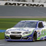 Casey Mears drives down pit road before going out on the track during a practice session for the NASCAR Sprint Unlimited auto race at Daytona International Speedway, Friday, Feb. 12, 2016, in Daytona Beach, Fla. (AP Photo/John Raoux)