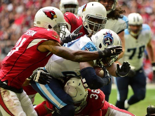 Titans running back Derrick Henry is tackled by Patrick