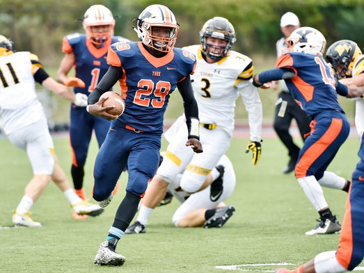 William Penn's Nigel Williams carries the ball in the