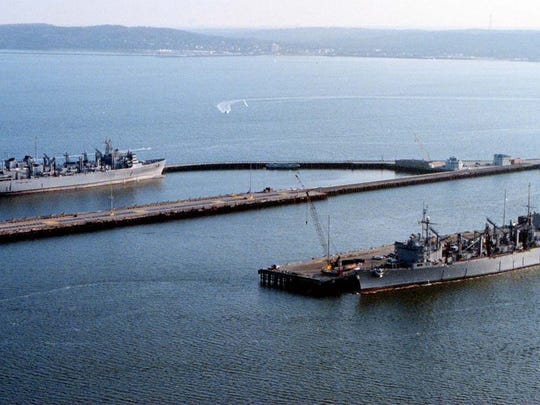 Two ships in port at the pier at Naval Weapons Station Earle in this 2000 file photo.