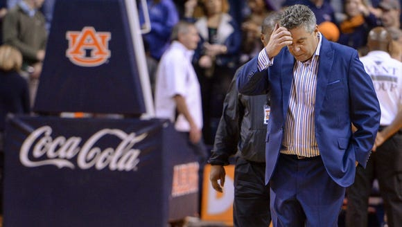 Auburn coach Bruce Pearl walks off the court after
