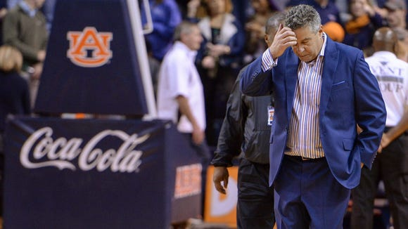 Auburn coach Bruce Pearl walks off the court after the team's 74-63 loss to Oklahoma State in an NCAA college basketball game Saturday, Jan. 30, 2016, in Auburn, Ala.  (Julie Bennett/AL.com via AP)