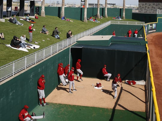 The outfield grass area overlooks the bullpen photographed here during the Cincinnati Reds- Arizona Diamondbacks game played at Goodyear Ballpark.